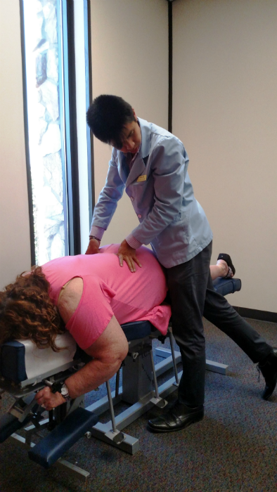 Ashley is seen here treating a patient, as a chiropractic intern.