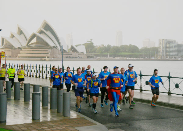 A warm welcome home for Morrow, by a large entourage of runners. Welcome Home Marathon, June 2014. - (Image credit: Carl Horn)