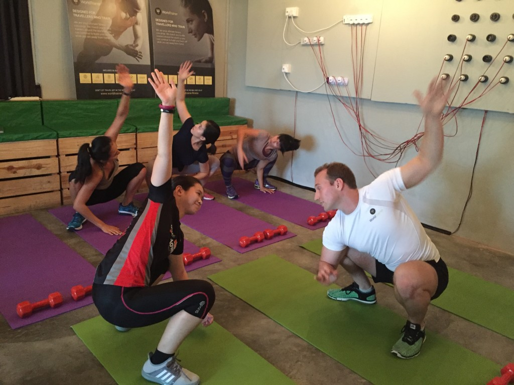One of WorldTrainer's personal trainers demonstrates to me, one of the bodyweight exercises.
