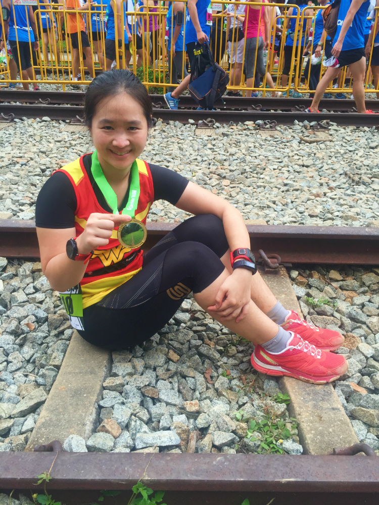 Resting on the Bukit Timah Railway tracks after my run.