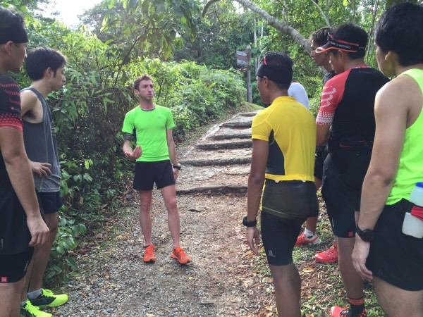 Vlad Ixel (in green tee shirt) shares tips with first-time 100km runners.