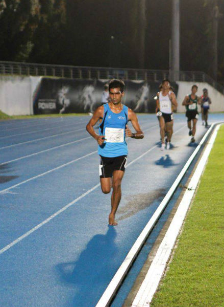 Powering to victory at the 10km race, IVP Track and Field Championships.