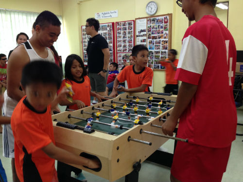 Kids from the Life Community Services Society play together with the soccer stars from the Singapore Disability Sports Council.