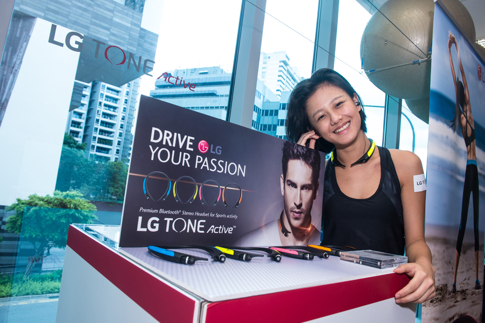 A model poses with the LG Tone Active headphones. (Photo by LG)