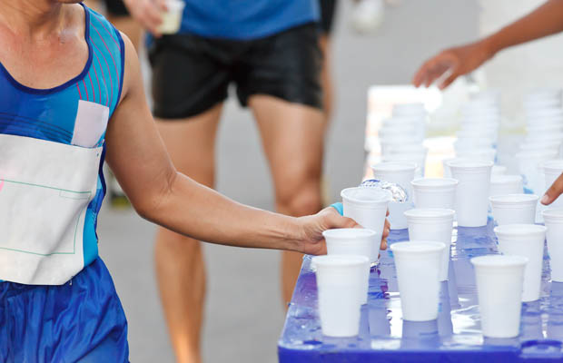 Hydration is important at a race, but don't overdo it. Photo by dailyburn.com