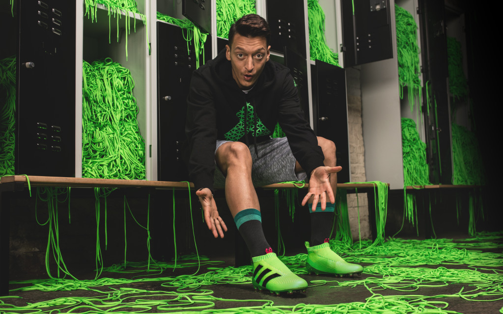 Arsenal's Mesut Oezil shows off the boots.