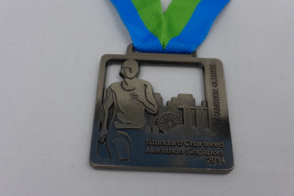An SCMS 2014 medal that Chan got, as a reward of his ordeal.