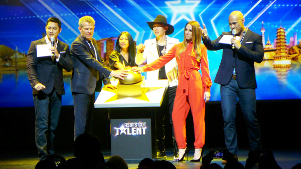 Posing with the Golden Buzzer - a special feature of the upcoming Asia's Got Talent, that will send a chosen contestant straight to the Semi Finals.