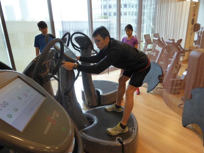 Our instructor, Joe, shows us how to warm up on the power plates.  (Photo Credit: Virgin Active).