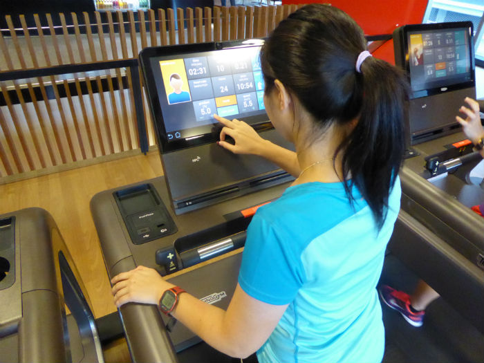 Adjusting the settings of the treadmill.  (Photo Credit: Virgin Active).