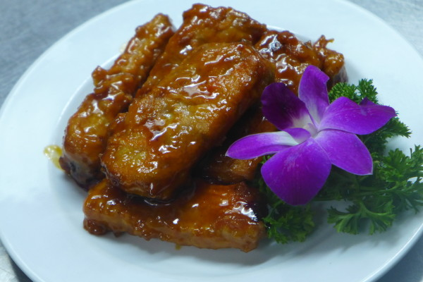 Carlsberg beer infused pork ribs are at the Thai Village Restaurant.