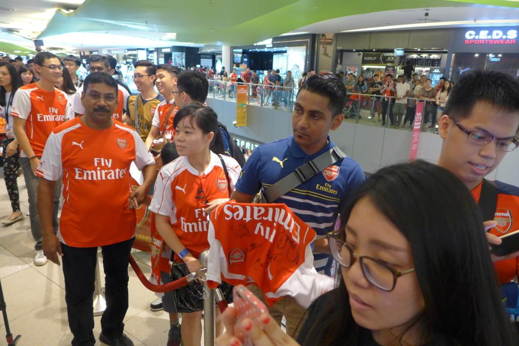 Arsenal fans wait their turn.
