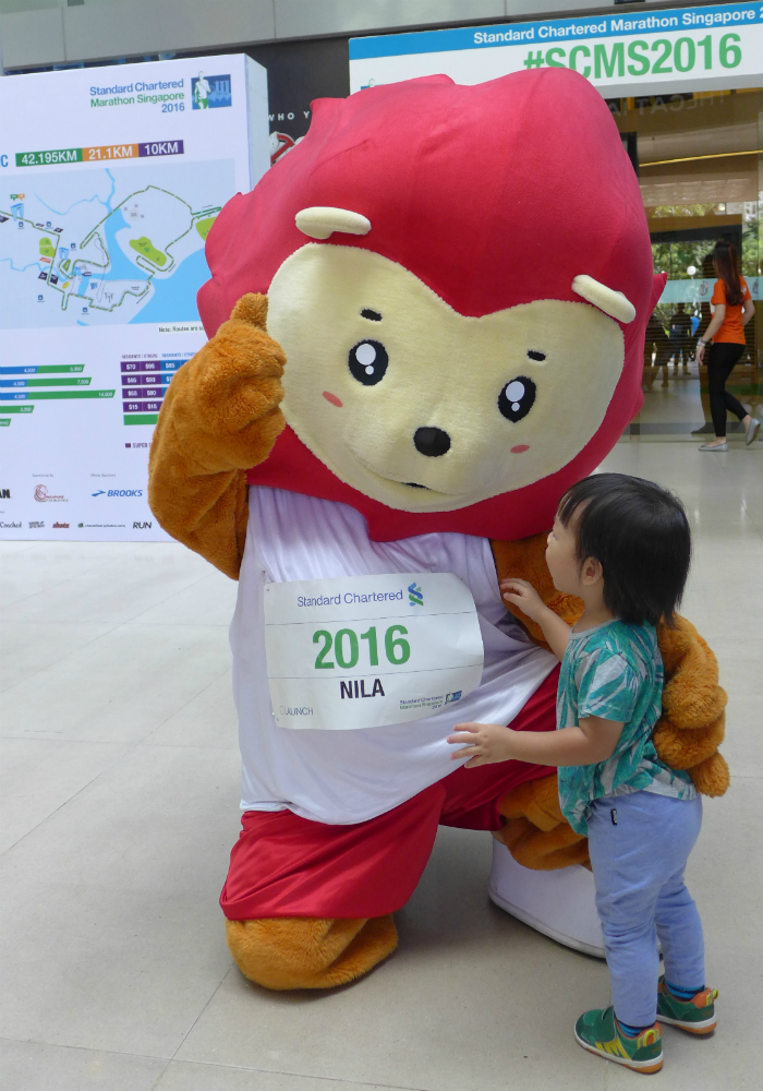 Team Singapore mascot, Nila entertains a young fan at the SCMS launch.