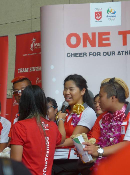 Yip speaks to the crowd while Theresa Goh watches on.