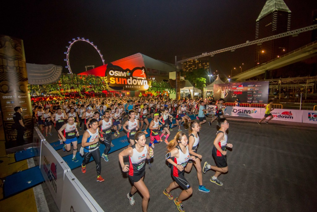 Your race strategy should be similar to that of a morning race. Photo Credit: OSIM Sundown Marathon 2015