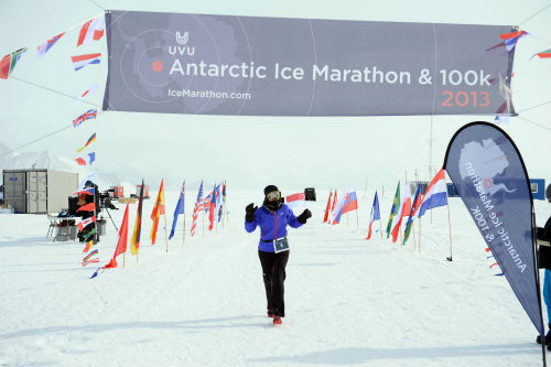 Yvonne crosses the finishing line at the Antarctic Ice Marathon. (Picture credit: Mike King)