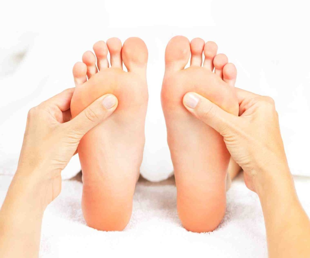 Foot Reflexology is all about stimulating pressure points on the foot. [Photo from www.aurora-massage.com]