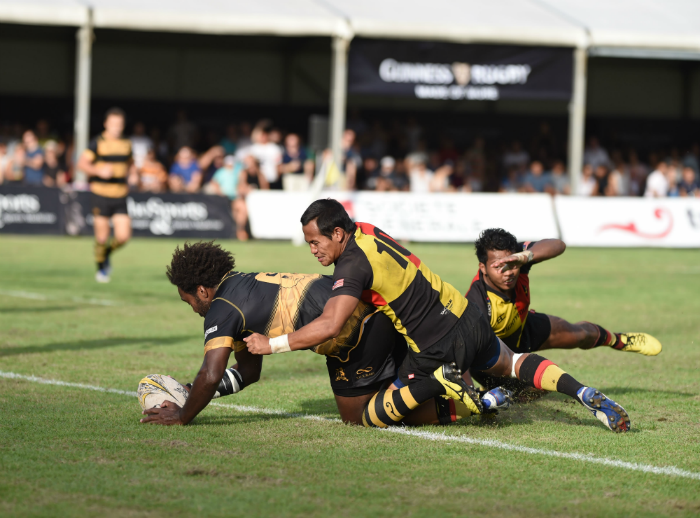 SCC's Valu Ratabi overcomes two players from the NS Wanderers as he scores an all-important try in their first Plate Final win in over 20 years at the 69th edition of the Singapore Cricket Club International Rugby Sevens.