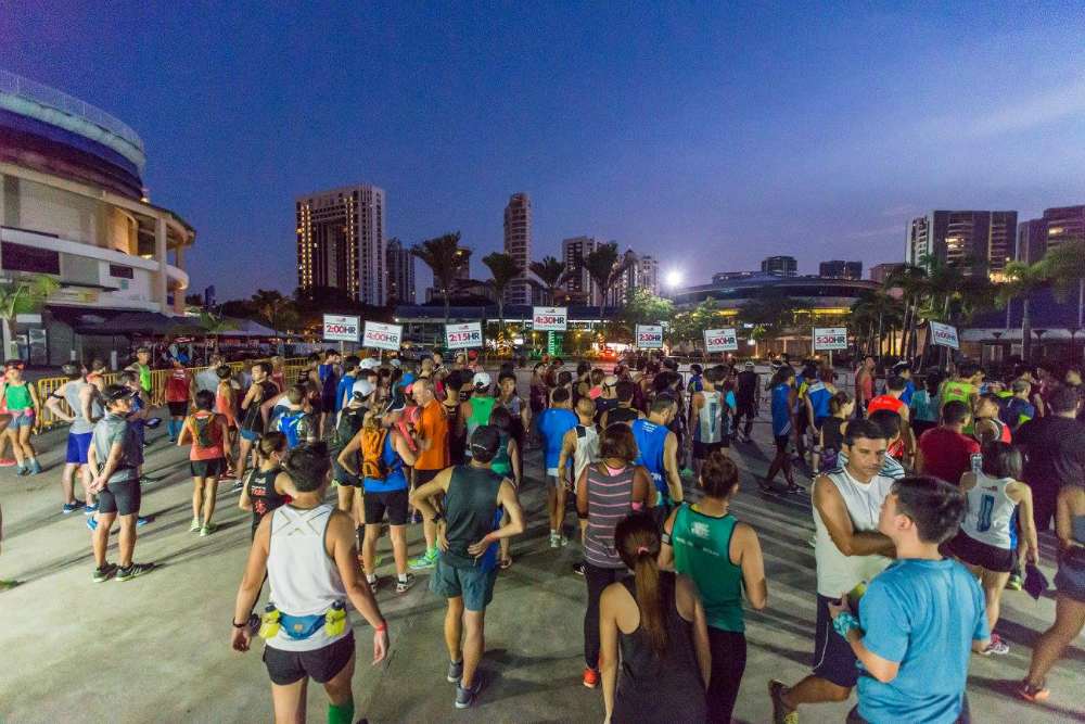 Runners congregate at ECP early in the morning. [Photo credit to OSIM Sundown Marathon]