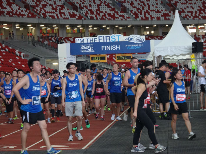 Triumphant runners are crossing the finishing line.