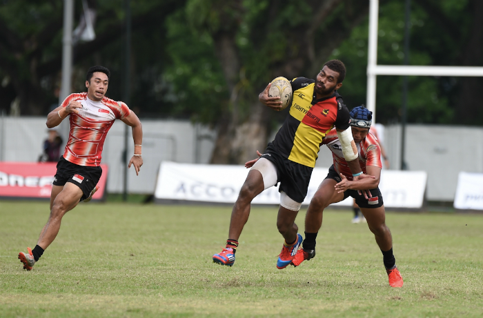 Singapore National Team's Marah Ishraf and Jay-Hykel Jailani looking to disrupt NS Wanderers' goal-scoring at the 69th edition of the Singapore Cricket Club International Rugby Sevens Plate Semi-final match. (Photo Credit SCC 7s)