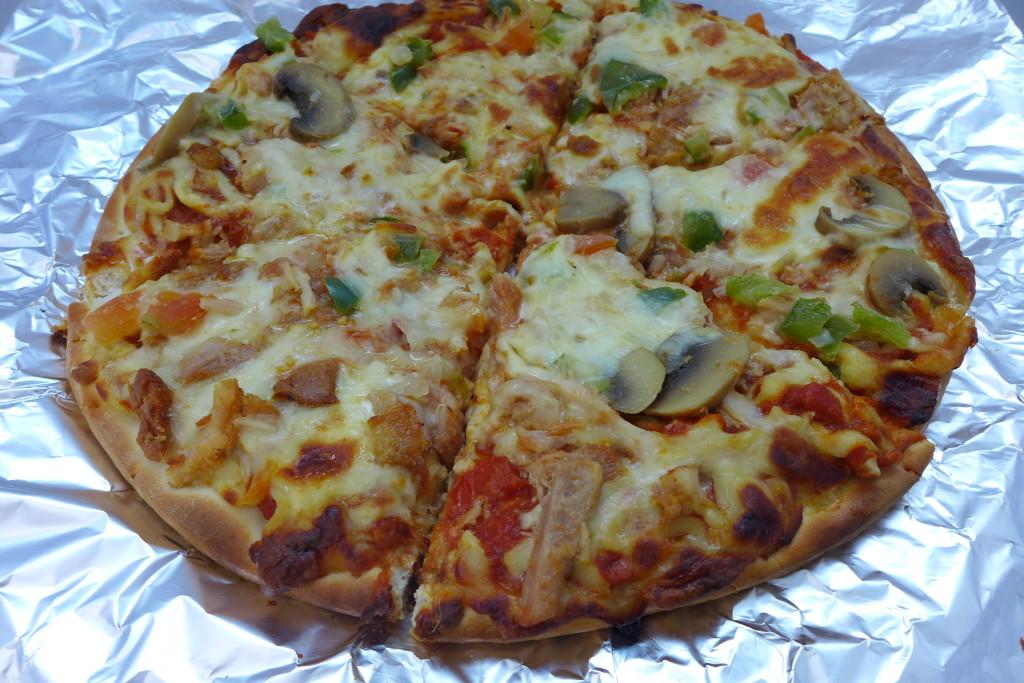 Tom Yum Chicken Pizza.