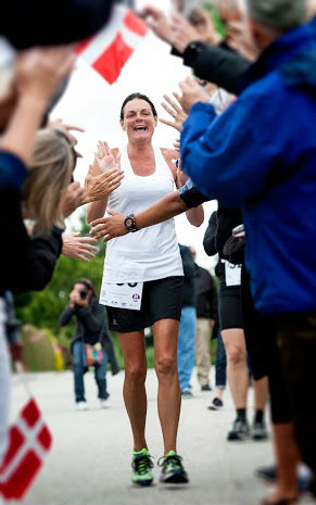Danish marathon runner Annette is all smiles, as she completes her 366th marathon.