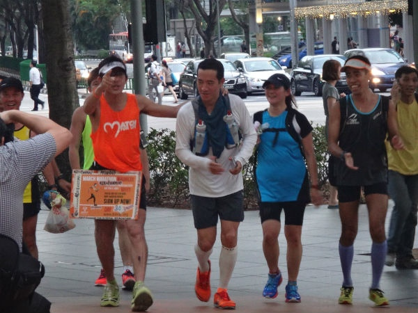 Ah Siao makes his appearance, together with the runners who ran with him.