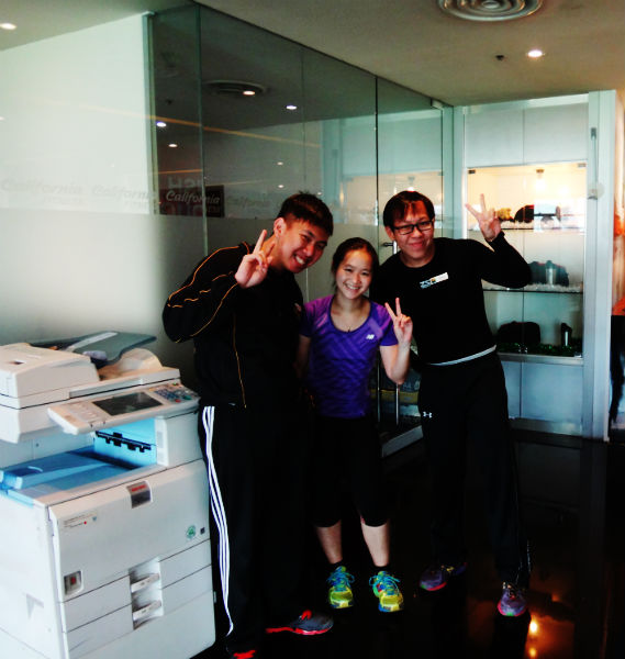 With the gym staff at the California Fitness gym.
