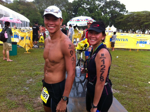 Dr Joanna Lin and her husband, Dr Kevin Yip, pose at the finish area of Ironman Melbourne.