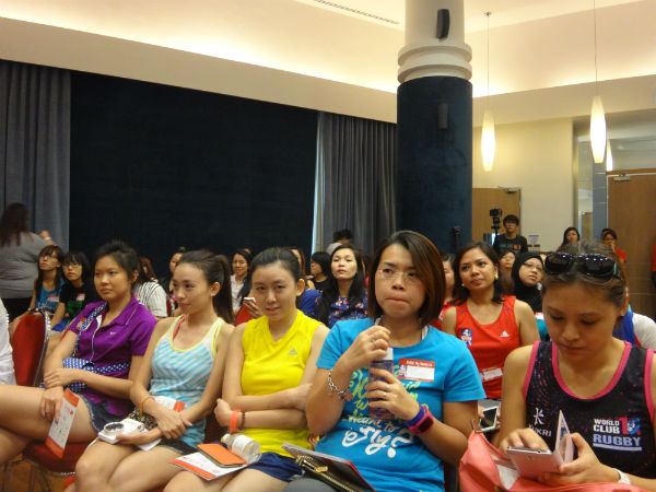 The audience is listening intently.