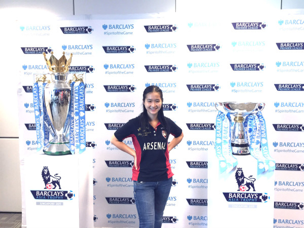 Between the Barclays Premier League trophy (left) and Barclays Asia Trophy (right).