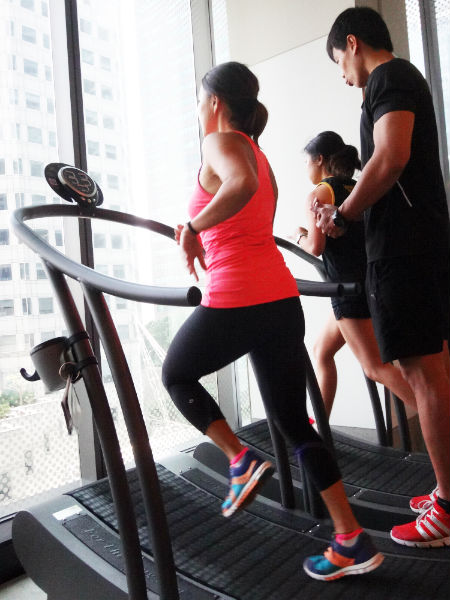 Running on the treadmill, under the instructor's guidance.
