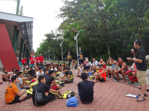 Participants are given a safety briefing before they jump into the canoes.