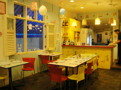 The cafe resembles a cosy doll's house on the inside.