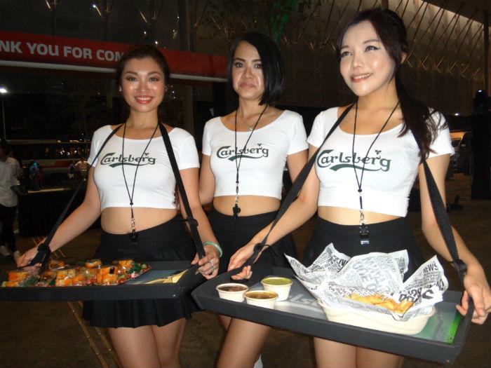The pretty Carlsberg ambassadors served football fans food all night.