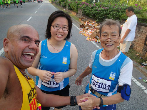 Meng Hui (far right) and a group of friends taking a selfie at the Penang Bridge International Marathon! (Reproduced with permission from Chan Meng Hui)