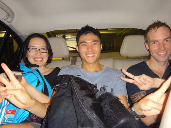 Mok and Russell chilling out after exercise, with Mok's girlfriend Belinda Ooi.
