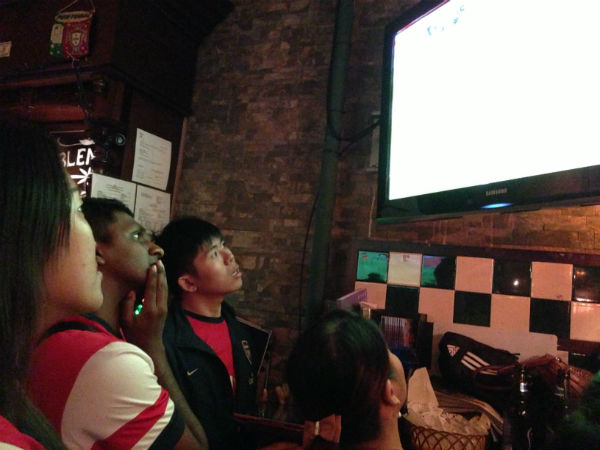 Fans watch the match in anticipation