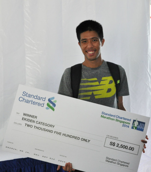 Team member Marcus Ong with the winning cheque.