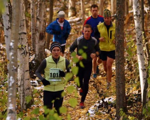 Runners battling against the woods at the Equinox Trail Marathon. (Image from newsminer.com)
