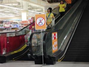 Frantically coming down the escalator.