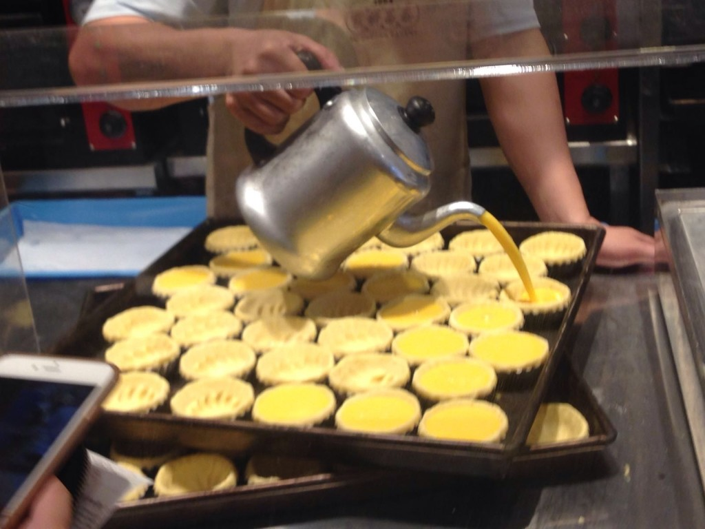 This is how the egg custard is poured out into the pastry shells.