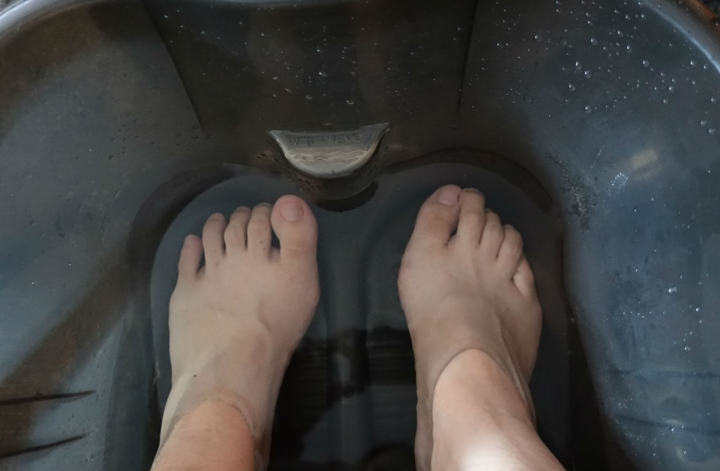 My feet getting soaked in warm water.