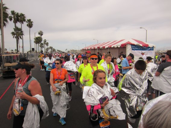 Runners celebrating their achievements after finishing the Surf City Marathon.
