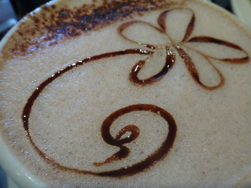 Creative flower design in the hot chocolate cup.