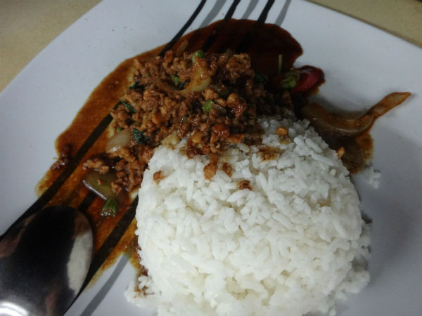 Ivan's hearty and nutritious dinner of Thai minced chicken with basil and rice.
