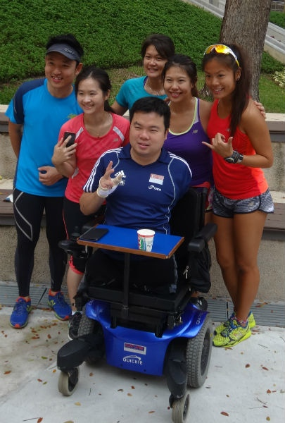 Jason Chee (front, centre) inspires other people, wherever he goes.