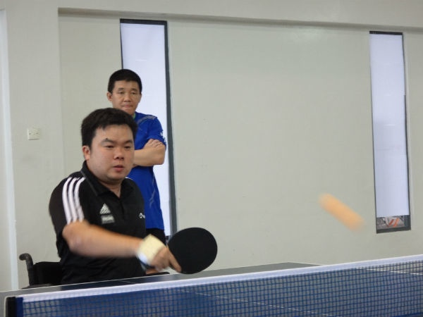 Jason is very focused on his table tennis game.