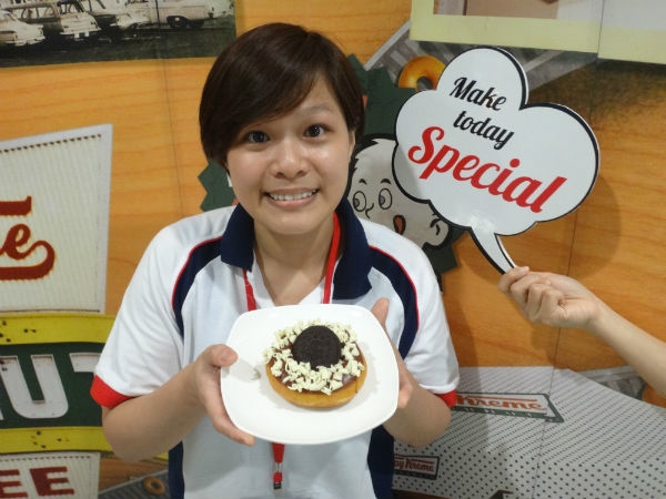 Office hero Jenny Lim, posing with her very own donut.